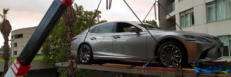 Premier Cranes lifting a car