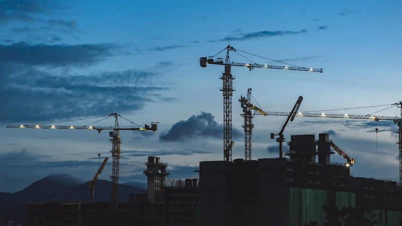 Cranes against a dark sky