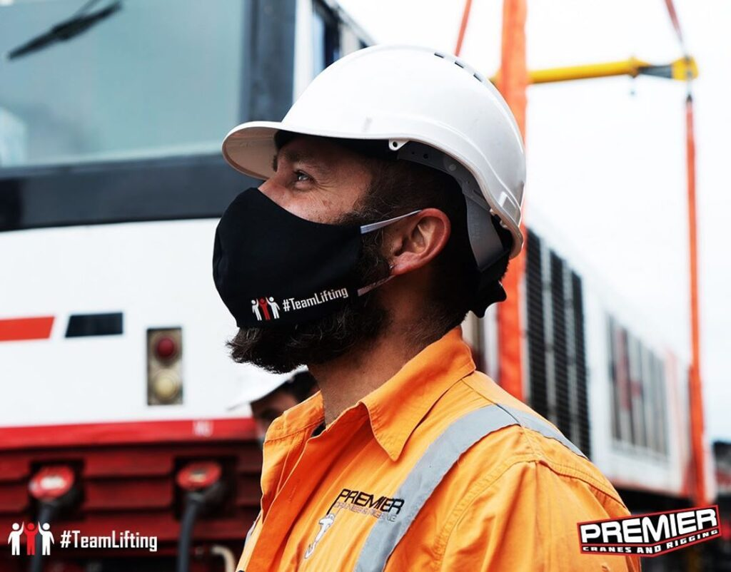 Premier Cranes and Rigging Employee wearing a mask